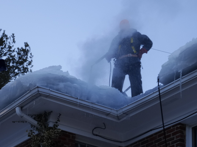 Chris Robinson Steaming Ice Dams & Wearing a Stainless Retractable Safety Harness