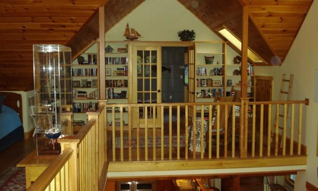 Library above the living room. Custom shelves built in Daggett's shop