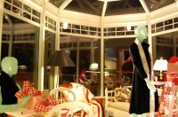 Sunroom at night, decorations provided by Nobleboro Antique Exchange