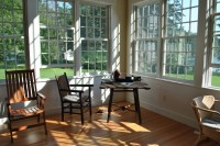 Custom sun room addition on an antique cape
