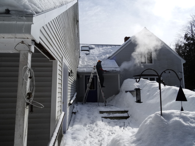Steaming the ice out of a gutter on a metal roof