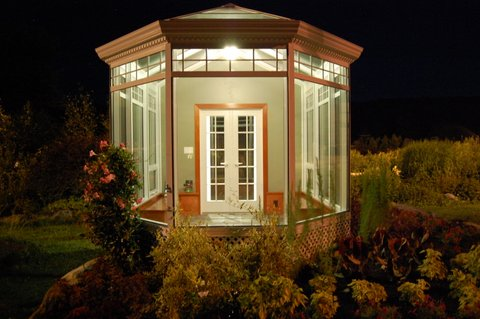 Solarium Trim Details lit up at night, Rockport, ME garden display at Plants Unlimited.