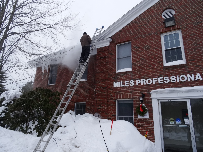 Removing icicles with a steamer