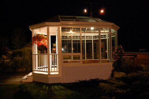 Small Portable Solarium with a Porch.  Beautiful Trim Details.  This sunroom was built on a trailer in Cushing, ME.