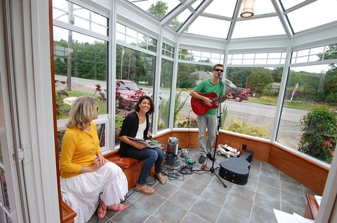 Brian Spotts playing music  and singing in our model solarium, Rockport, ME